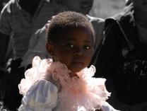 A photo of little african girl in sunday best